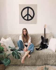 woman sitting in grey fur sofa